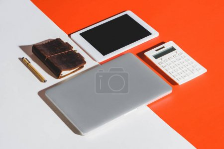 Photo for Flat lay with laptop, digital tablet, calculator and office supplies - Royalty Free Image