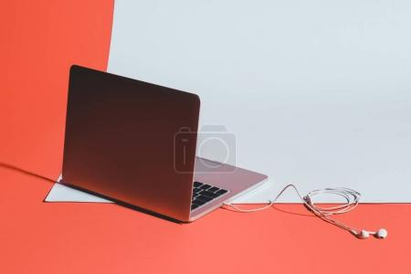 laptop and earphones