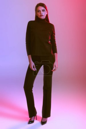 Photo for Beautiful stylish girl posing in black clothes, on pink - Royalty Free Image