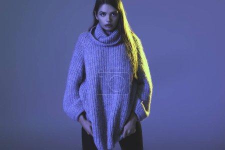 girl in trendy sweater