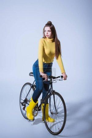 fashionable girl with bicycle