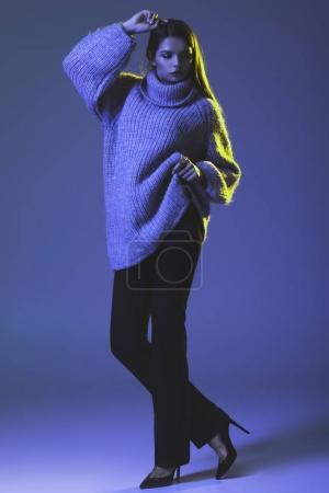 stylish girl in warm sweater