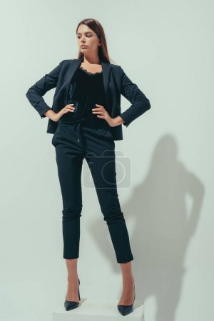 girl posing in suit