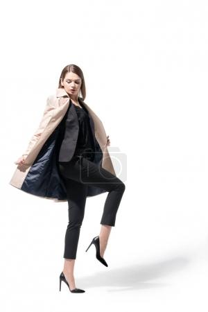 girl in suit and trench coat