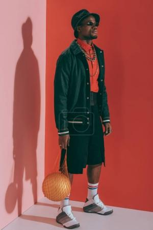 man with golden ball in string bag