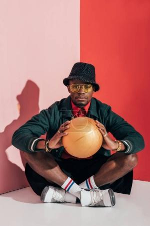 stylish african american man with ball