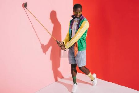 Photo for Full length view of stylish young african american man playing golf in studio - Royalty Free Image