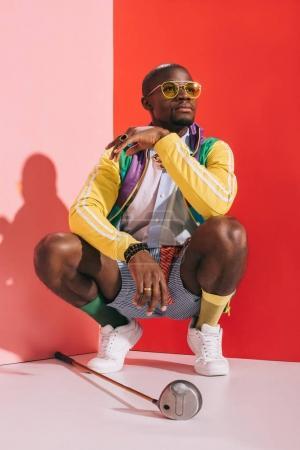 stylish man with golf club