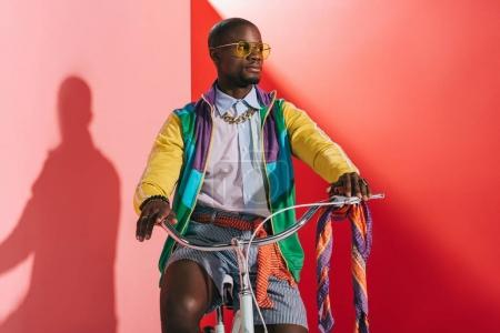 stylish african american man on bicycle