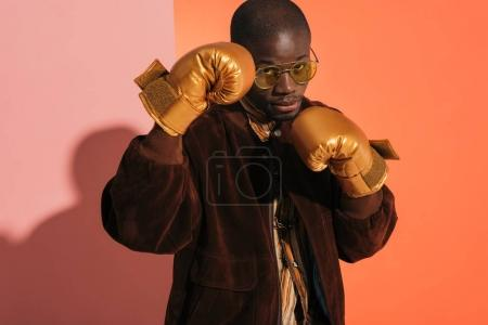 stylish man in boxing gloves