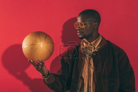 stylish man with golden ball