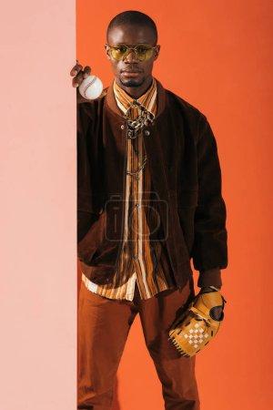 stylish man with baseball glove