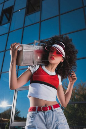 beautiful woman with boombox