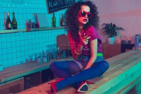 fashionable woman with cocktail