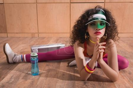 beautiful woman stretching on floor