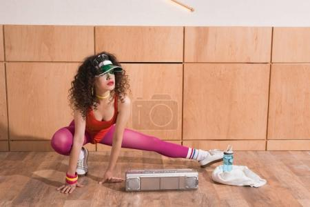 woman stretching before training