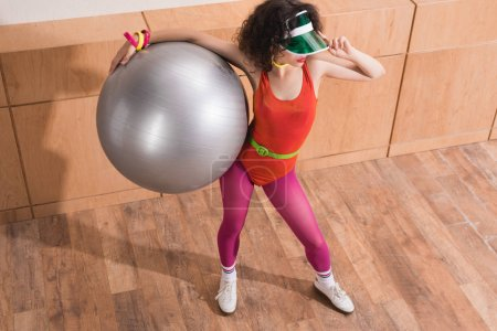 fashionable woman with fitness ball