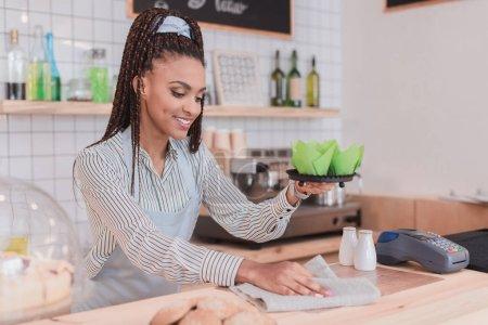 barista wiping counter