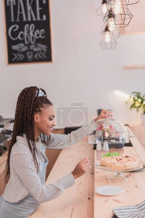 barista taking piece of pie