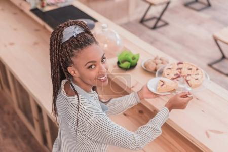 barista holding piece of pie