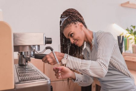 barista making coffee with machine