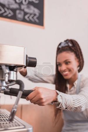 barista making coffee with machine