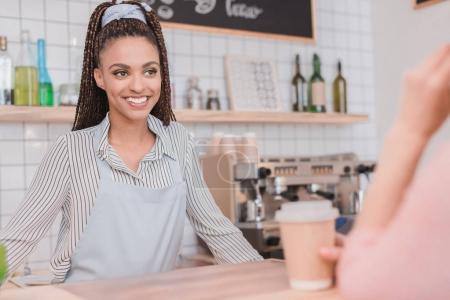 barista standing behind counter