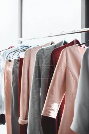 Photo for Different trendy clothes hanging on hangers in boutique - Royalty Free Image