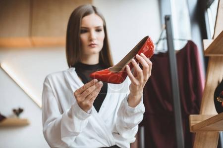woman choosing heels