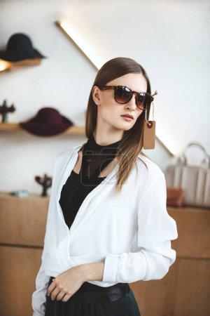 woman in stylish sunglasses