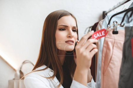 Woman looking on sale tag