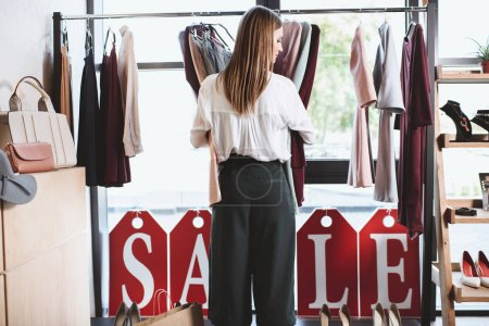 shopaholic with clothes and shopping bags