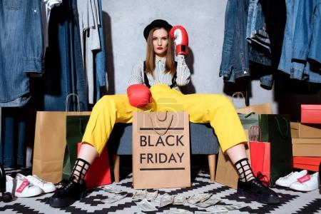 girl in boxing gloves on black friday