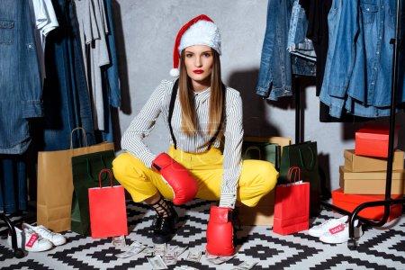 girl in santa hat in boutique