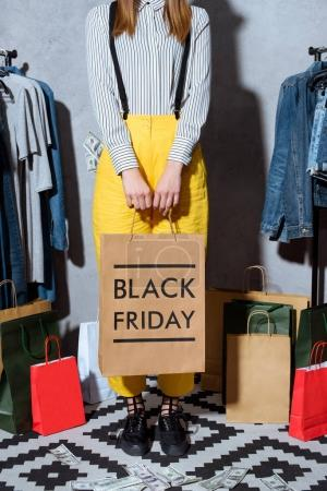 girl with shopping bag on black friday