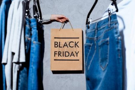 hand with shopping bag on black friday