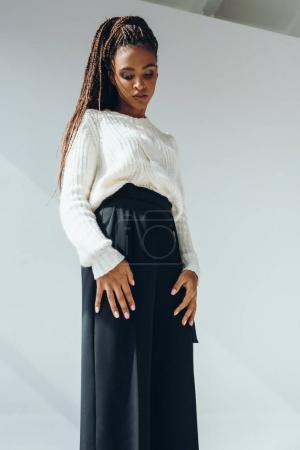 girl in trendy black pants