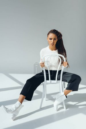 trendy african american girl with chair