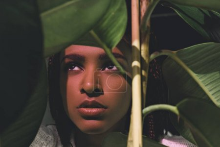 African american girl with green leaves