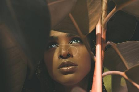 african american girl with houseplant