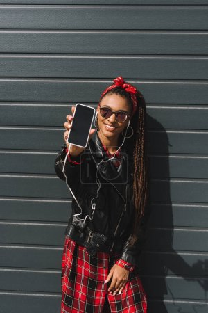 Stylish african american girl with smartphone