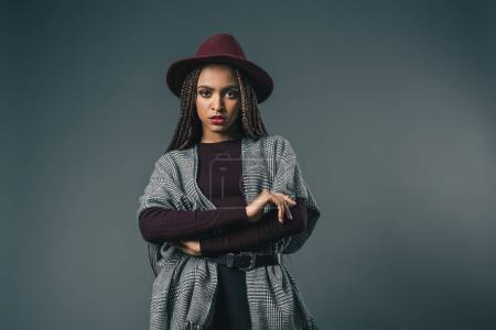 Photo for Beautiful stylish african american girl in hat looking at camera isolated on grey - Royalty Free Image