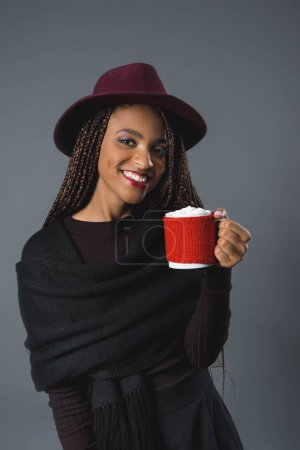 girl holding cup with marshmallows