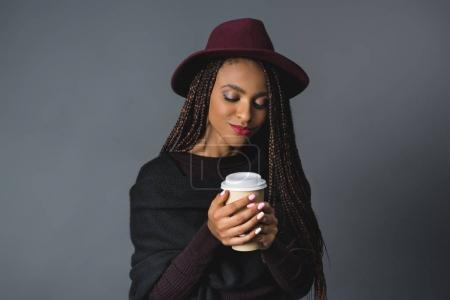girl with disposable coffee cup