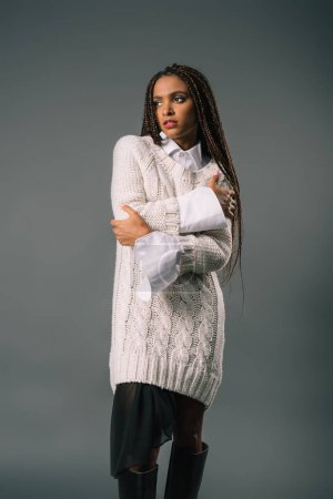Photo for Elegant african american woman in stylish knitted sweater looking away isolated on grey - Royalty Free Image