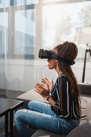 Photo for Shocked emotional african american woman in vr headset - Royalty Free Image