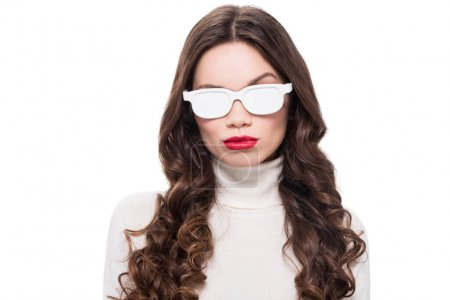 woman in white sunglasses raising brow