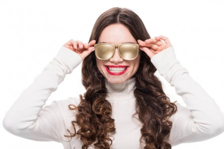 Photo for Portrait of young smiling woman with bright makeup wearing gold opaque sunglasses, isolated on white - Royalty Free Image