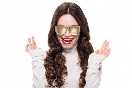 Smiling woman in gold sunglasses