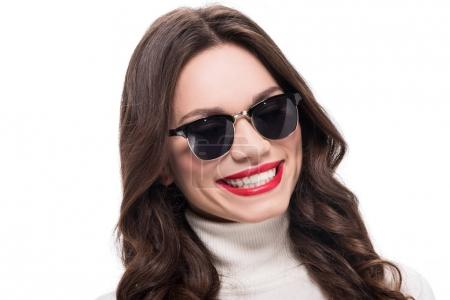 Cheerful woman in trendy sunglasses